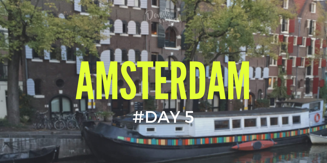 itinerario amsterdam donuts on bed travel blog